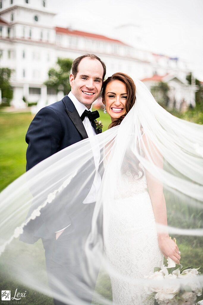classic wedding portrait with long veil blowing toward camera at Wentworth By The Sea Hotel wedding