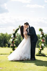 couple kissing after the ceremony on the gold course, hayley paige gown