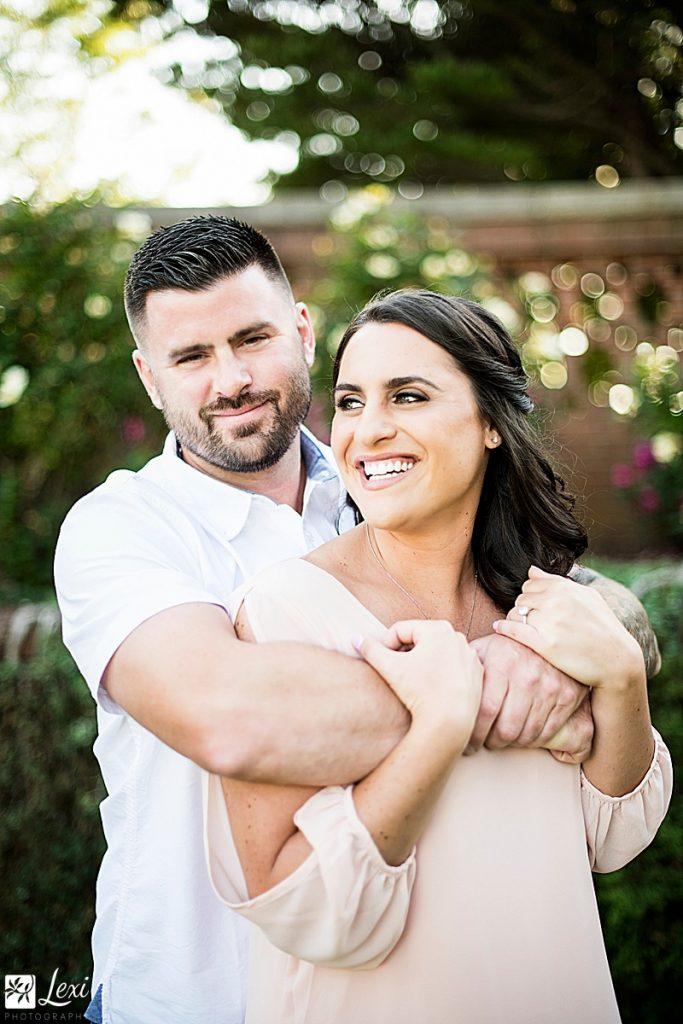 couple smiling in Lynch Park rose garden