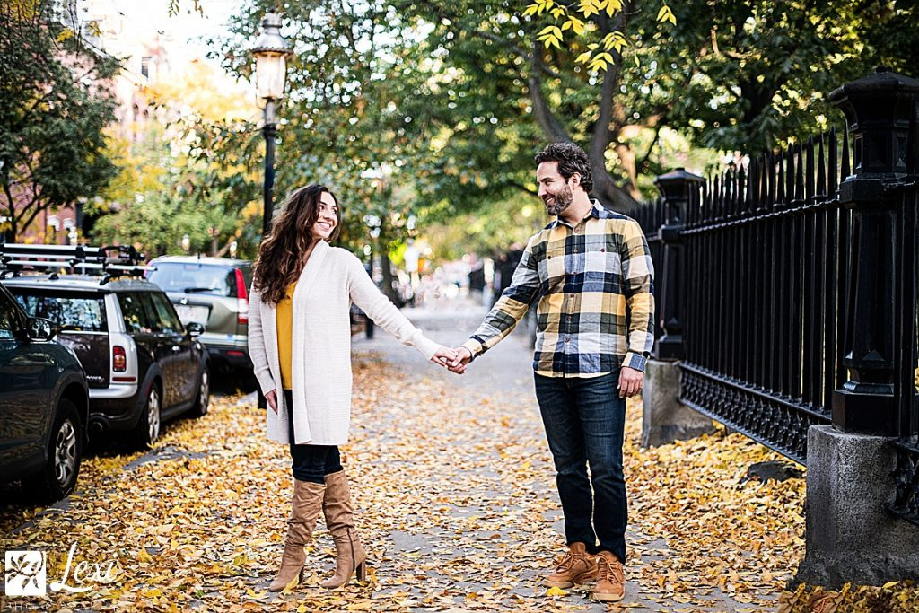 couple holding hands by Bunker Hill Monument in charlestown