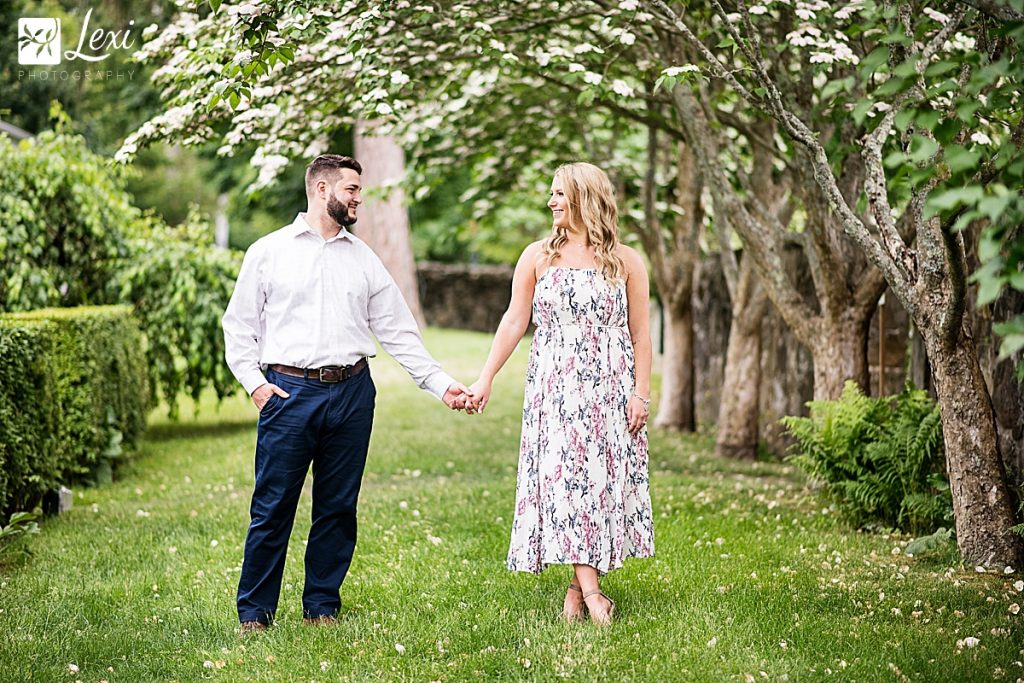 couple standing under flowering tree in stevens coolidge place