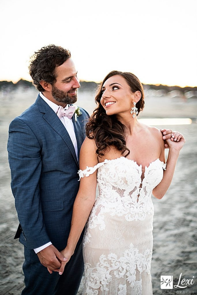bride and groom on the beach in summer
