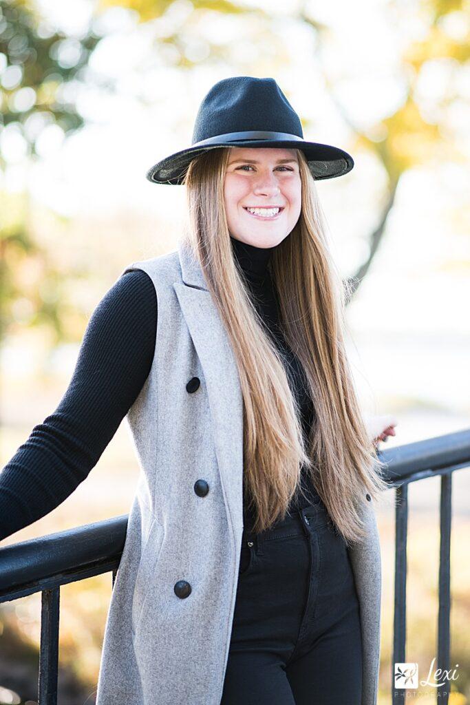 high school senior wearing hat on Boston esplanade