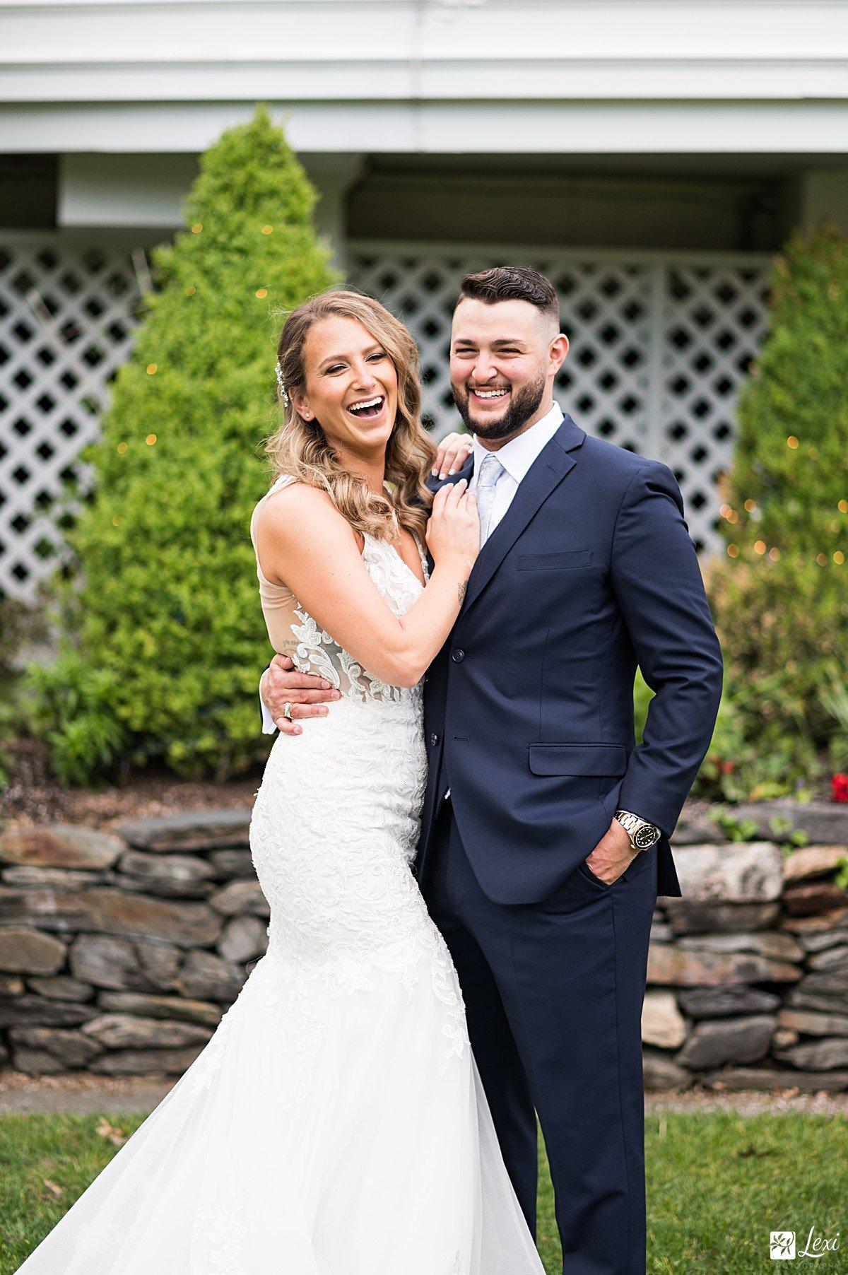 bedford-village-inn-wedding-bride-and-groom-laughing.jpg